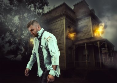 businessman near burning house