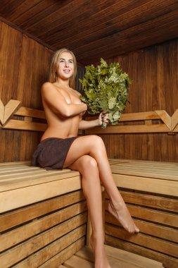 Beautiful female in bathhouse.