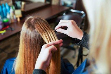 Professional hairdresser using foil