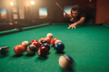 Man hitting pyramid in billiards