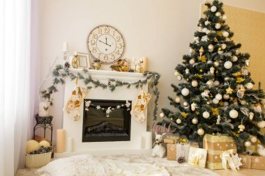 Holiday interior with fireplace and Christmas tree