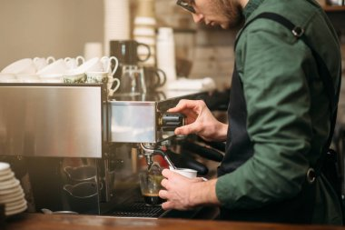 Man making coffee with coffee machine