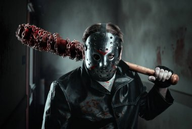 Serial murderer holding bloody bat