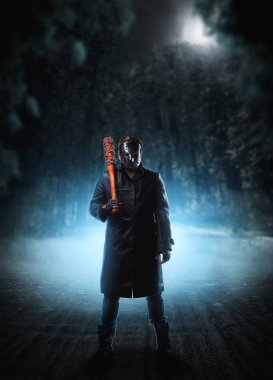 Evil embodiment in hockey mask and black leather coat with bloody baseball bat with a chain wrapped around against dark sky on background. stock vector
