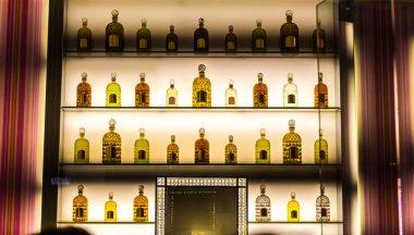 bottles of alcohol on backlit shelves