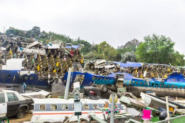 waste deposit with crashed plane and cars