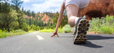 runner on asphalt road