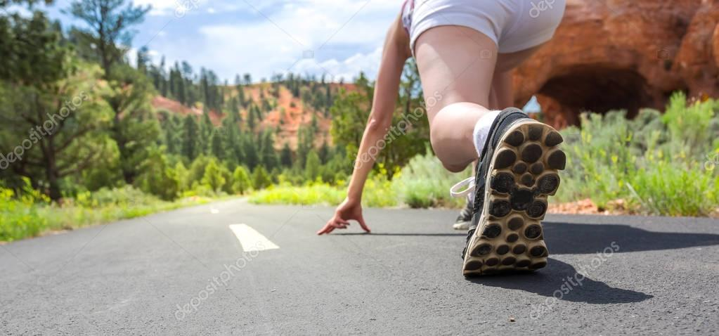runner on asphalt road