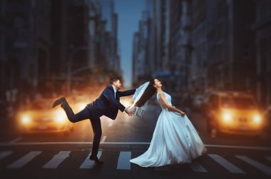 groom in suit and bride in white dress