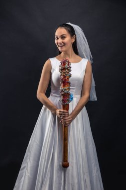 bride holding baseball bat