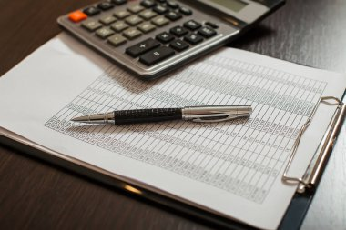 accounting documents and calculator