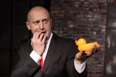 professional agent holding toy duck