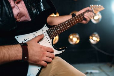 male guitarist with electric guitar