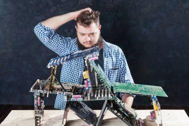 Repairman making electronic components diagnostic
