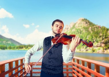 Male musician playing violin