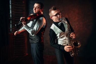 Male musicians playing saxophone and violin