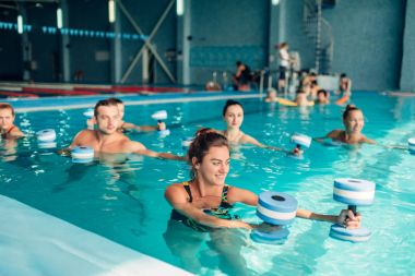 aqua aerobics workout with dumbbells