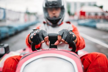 Karting racer wearing helmet