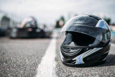 Racer helmet on asphalt