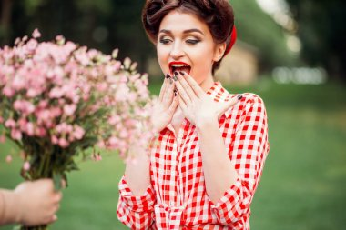 young woman with pin-up makeup and hairstyle