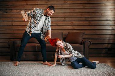 young man beating woman