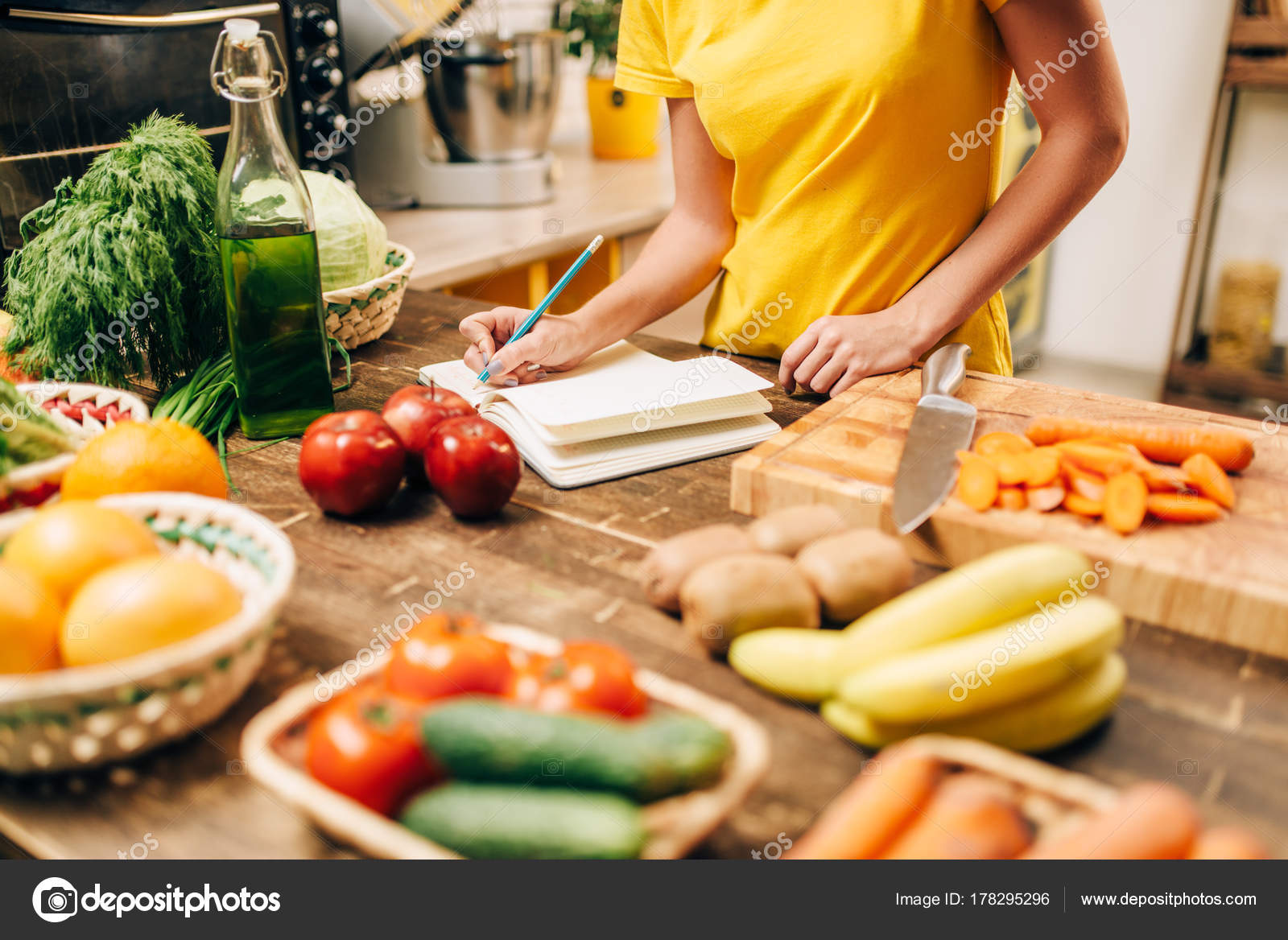 Young woman cooking kitchen writing recipe book healthy food young woman cooking kitchen writing recipe book healthy food vegetarian stock photo forumfinder Image collections