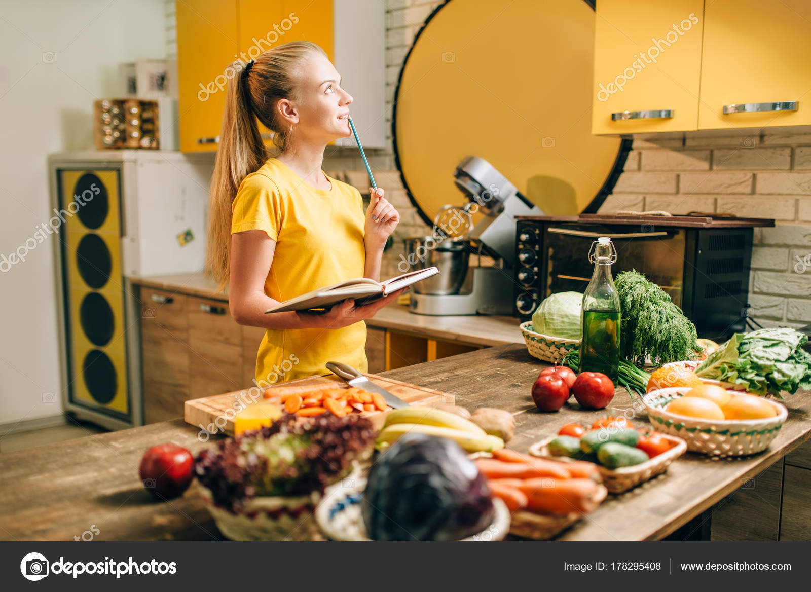 Young happy woman cooking recipe book healthy food vegetarian diet young happy woman cooking recipe book healthy food vegetarian diet stock photo forumfinder Gallery