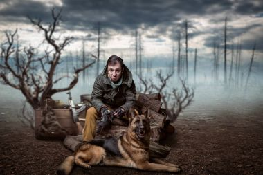 stalker with gas mask in hands and dog, friends in post apocalyptic world. Polluted nature on background