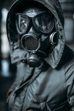 stalker concept, male person in gas mask, radiation danger. Post apocalyptic lifestyle, doomsday