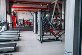 gym interior, exercise machines and sport equipment