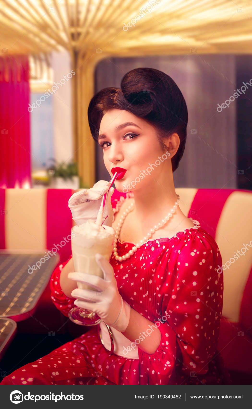 Sexy pin up woman with make up drinking milkshake in retro cafe popular retro american fashion photo by nomadsoul1