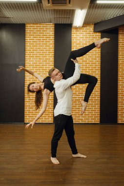 Contemporary dance performers, couple training in studio. Male and female dancers on workout in class, modern dancing, stretching exercise