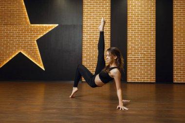 Contemporary dance performer, woman in studio, body flexibility. Dancer on workout in class, modern ballet, elegance dancing