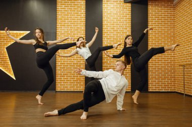 Contemporary dance performers posing in studio. Female and male dancers training in class, modern grace dancing, stretching exercise, acrobats