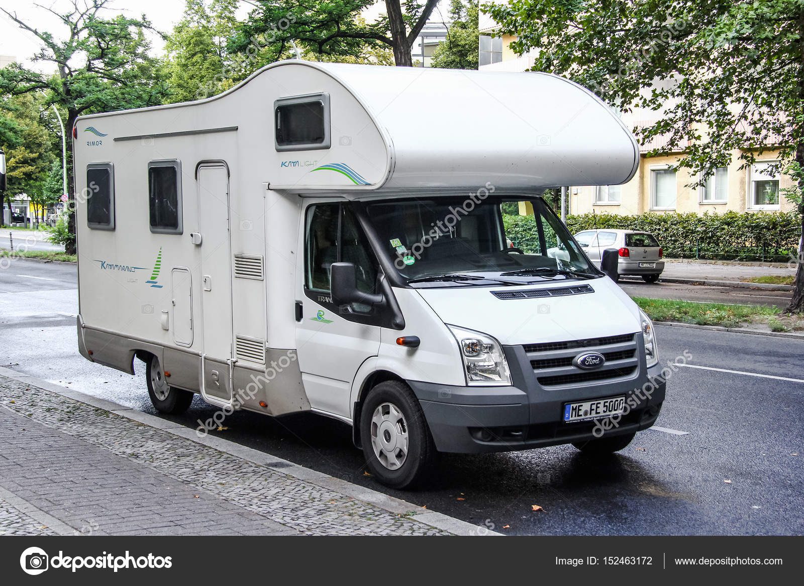 Berlin germany august 16 2014 white caravan ford transit in the city street photo by artzzz