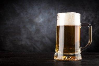 Beer mug on black background