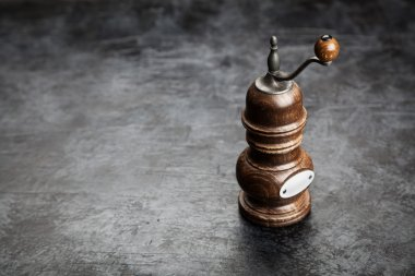 Pepper grinder on dark background