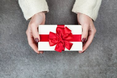Present box in womans hands