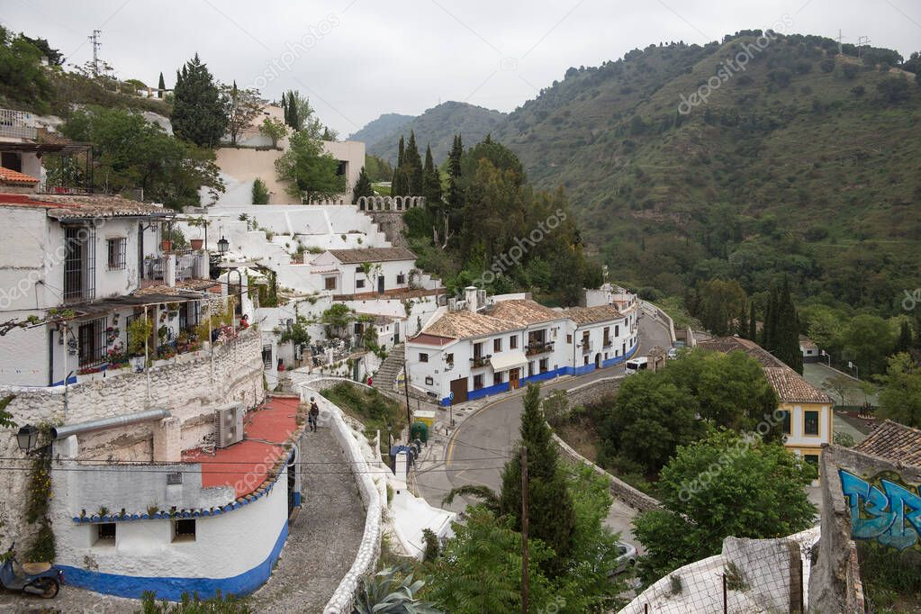Sacromonte village famous for its houses made in caves at the hill slopes, Granada, Spain