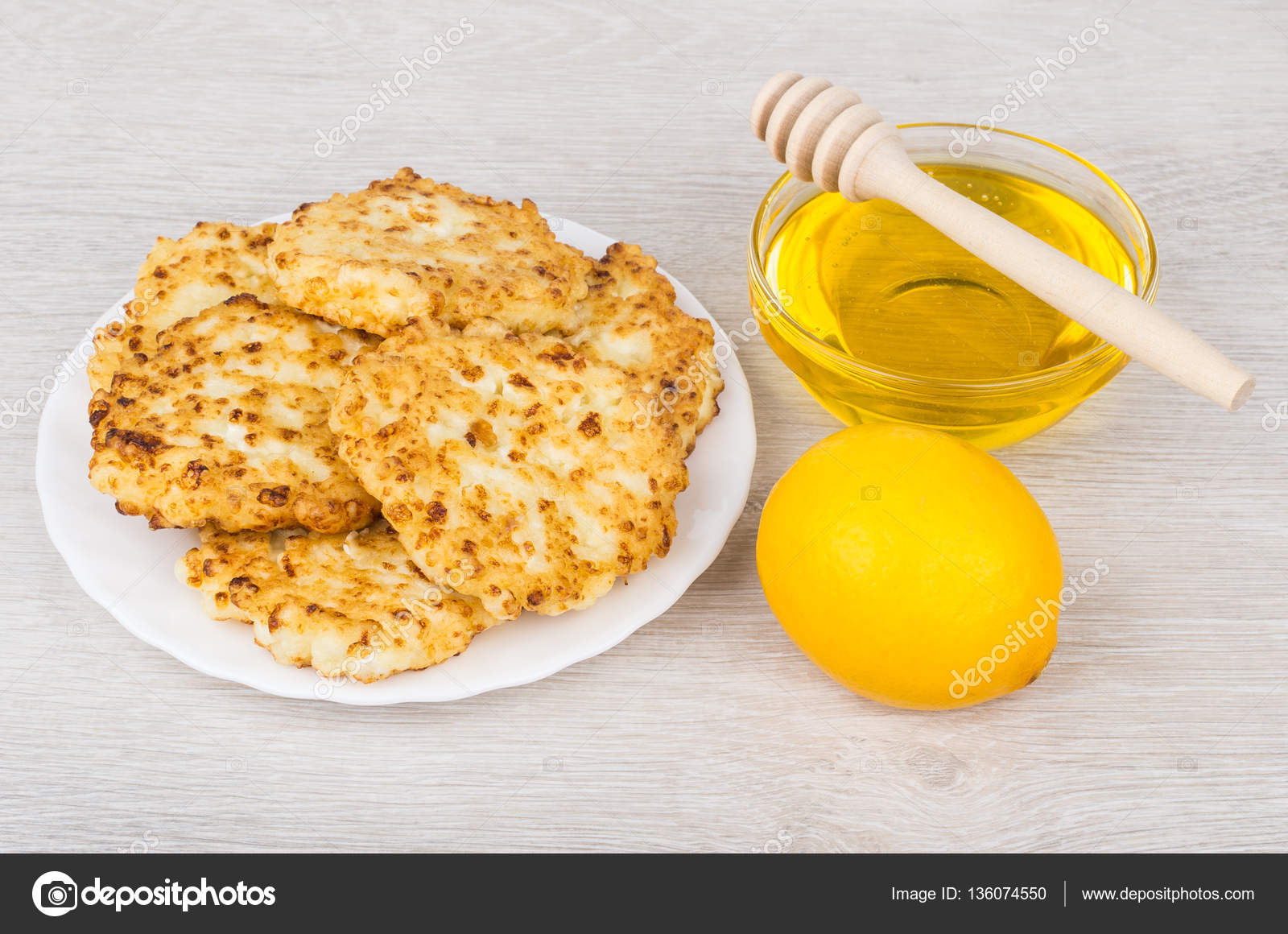 Cottage Cheese Pancakes In Plate, Bowl With Honey And Lemon On Table U2014  Photo By Firstblood