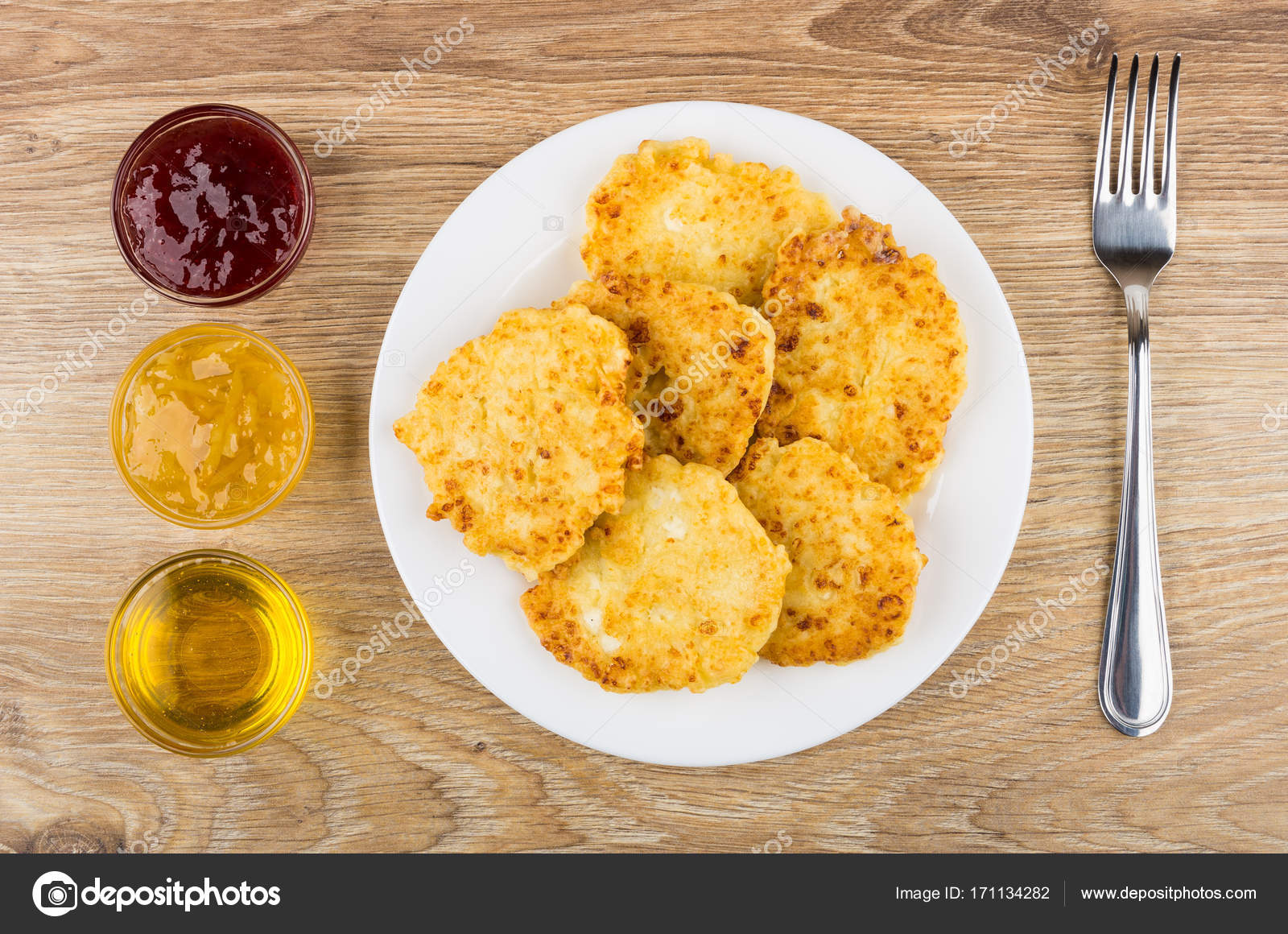 Cottage Cheese Pancakes In Plate, Bowls With Strawberry Jam, Lemon Jam,  Honey And Fork On Wooden Table. Top View U2014 Photo By Firstblood