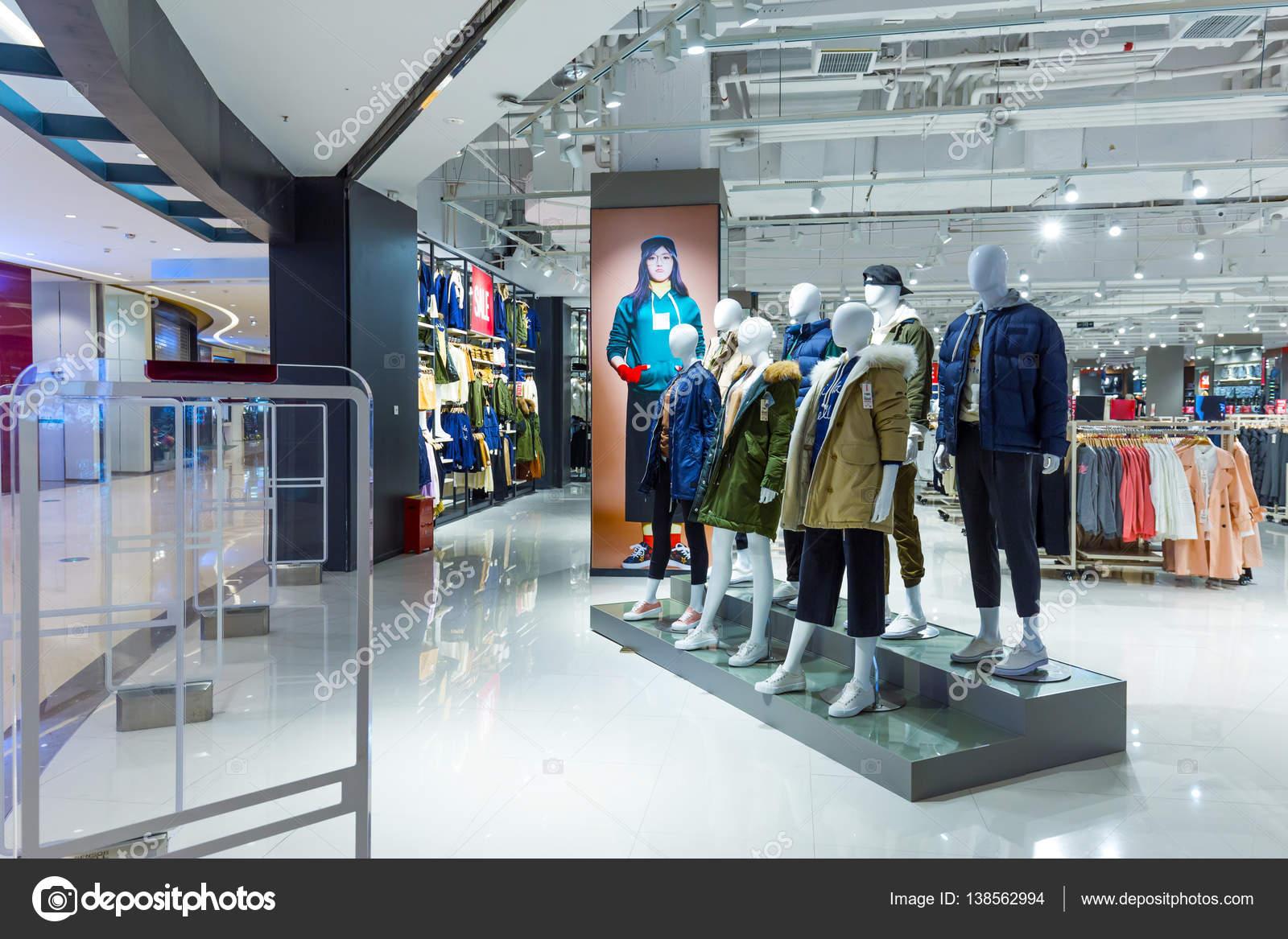 b0abb05881cda Fashion clothes in shopping mall – Stock Editorial Photo © zhudifeng ...