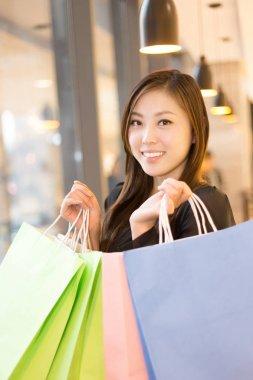 asian woman shopping in shopping mall