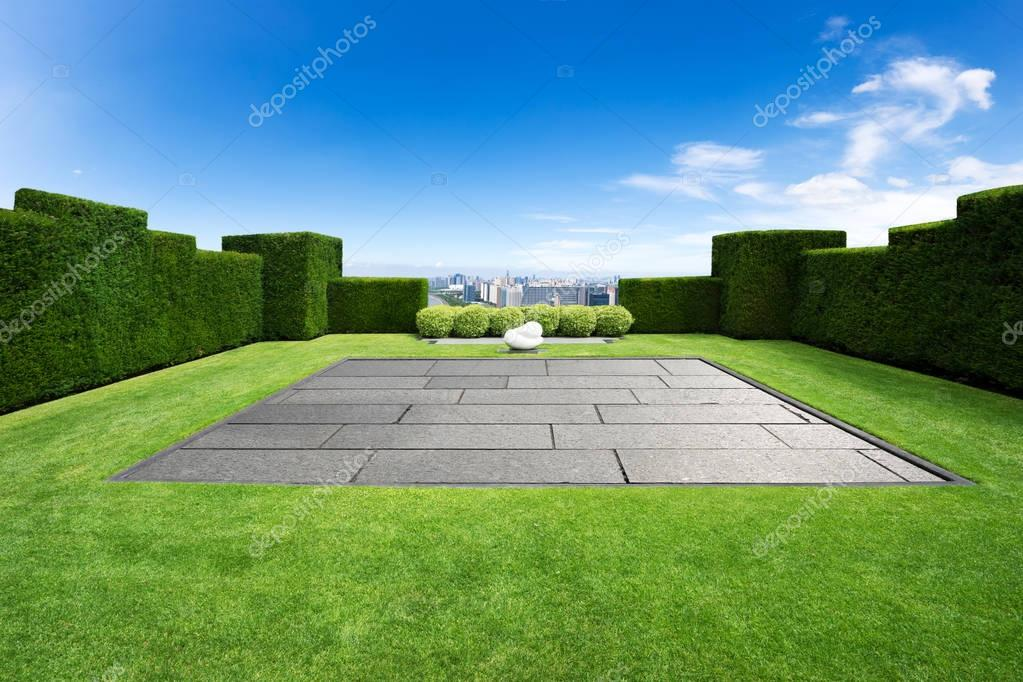 empty meadow and cityscape of modern city