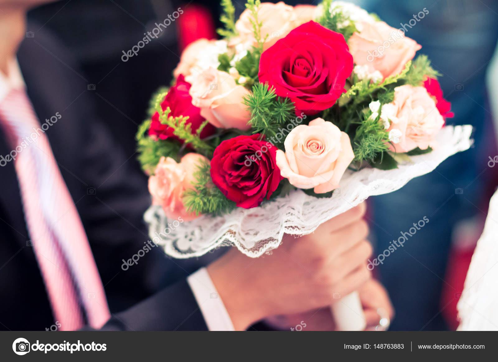 Beautiful fresh flowers on wedding stock photo zhudifeng 148763883 beautiful bunch of fresh flowers in hands on wedding photo by zhudifeng izmirmasajfo Gallery