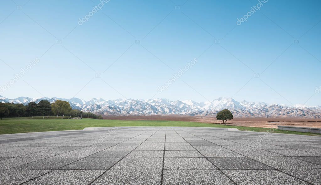 empty brick floor with snow mountains