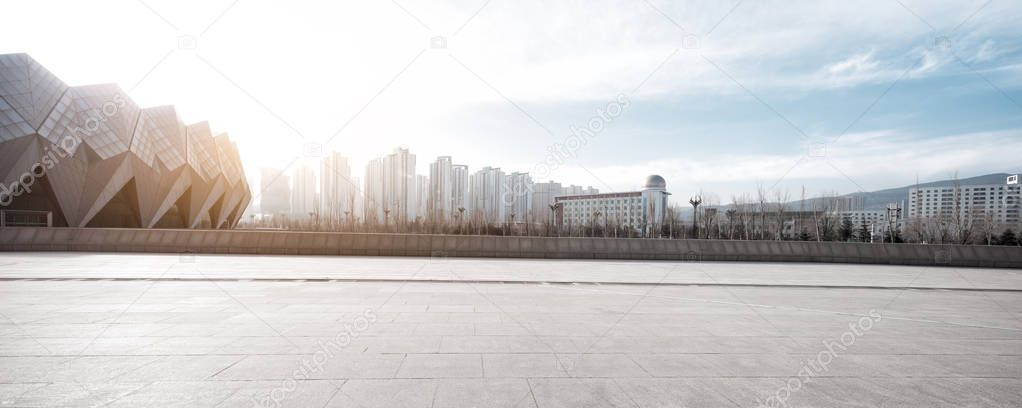 empty floor with cityscape of modern city