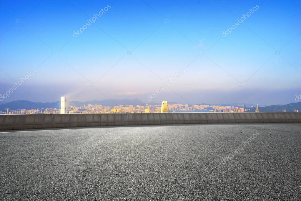 empty road with cityscape of modern city