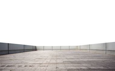 empty brick floor surrounded by concrete wall in blue sky