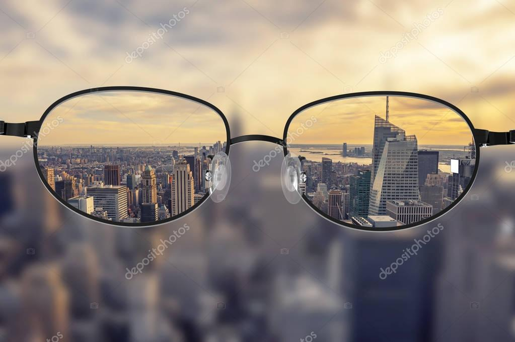 Фотообои Clear cityscape focused in glasses lenses
